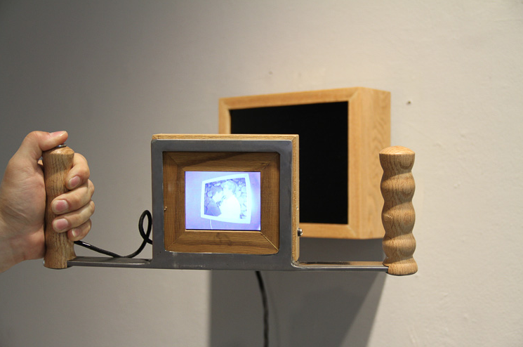 Here, an image is revealed by the use of a viewing machine. Viewers are available on a pedestal in the center of the room.
