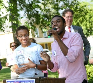 Alexandra Poindexter (left) and Quinlan Mitchell (right) at a Women's Equality Agenda Rally in Susan B. Anthony Park during Rocxxy 2013