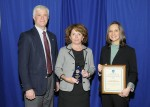 Recycling coordinator, Amy Kadrie (right), and director of support operations, Pat Beaumont (middle), receive Environmental Excellence Award from DEC commissioner, Joe Martens (left).