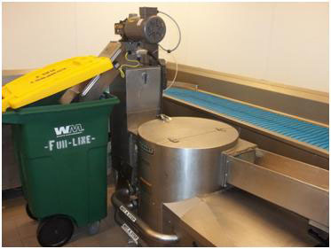 Pulper machine in Danforth Dining empties material directly into compost collection container.