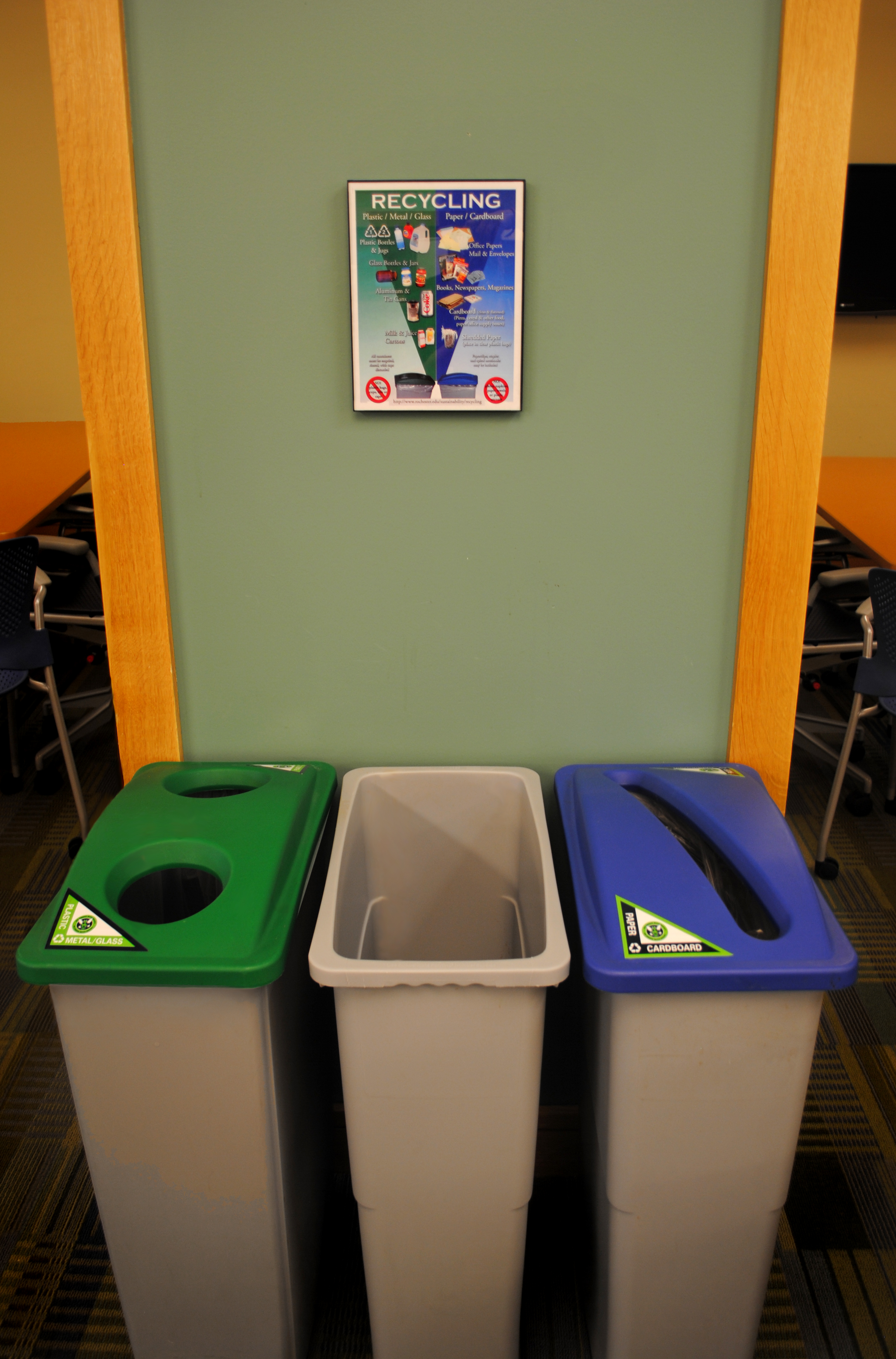 three recycling bins