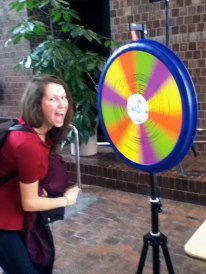 Student spinning the trivia wheel at the Green Energy Fair