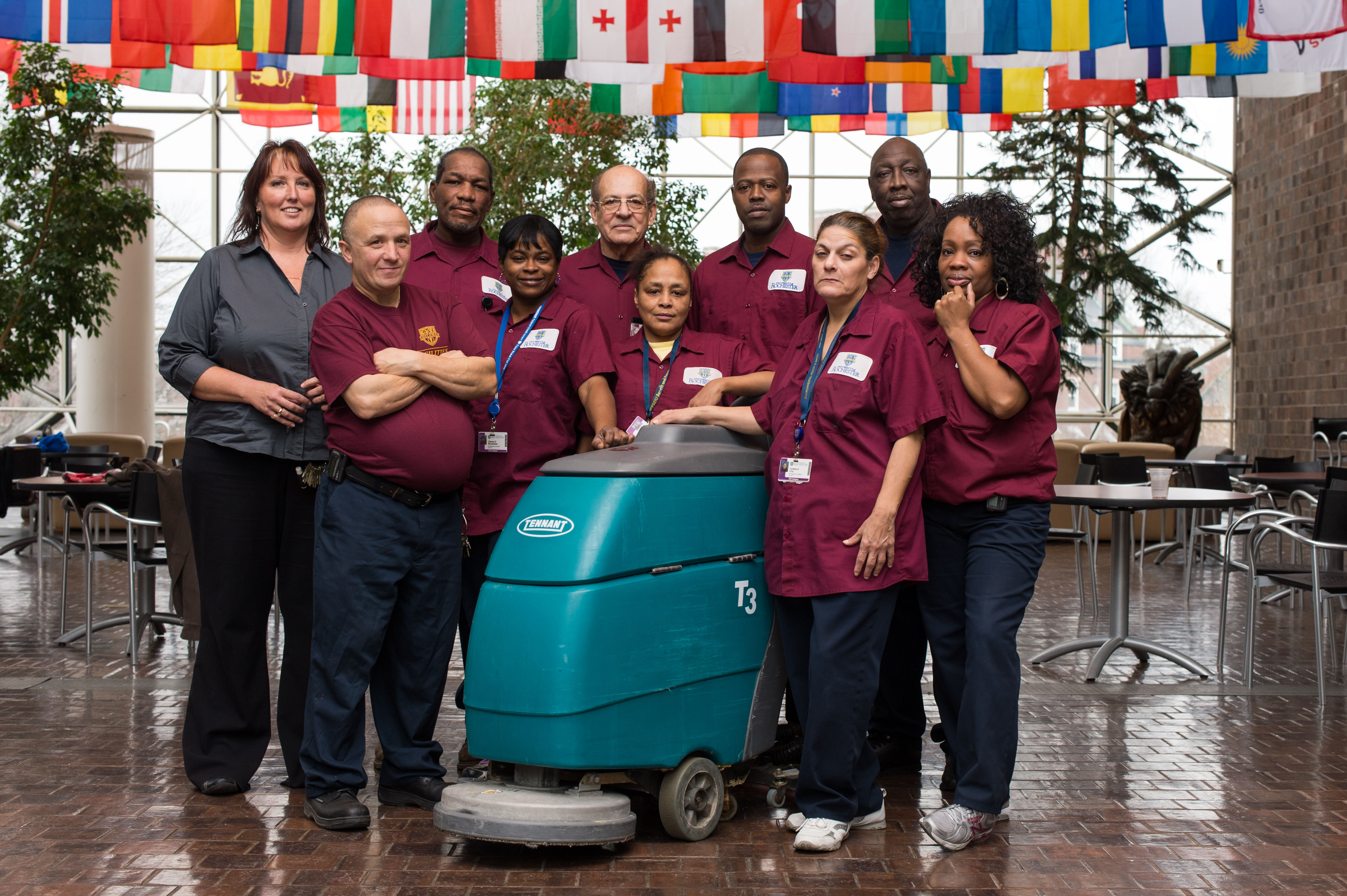 RC Environmental Services shown left to right; Area Supervisor Dorrene London, Environmental Service Workers Bobby Lazzara, Dennis Lee, Cherise Richardson, Leo Hodge, Marian Hill, Ron Jefferson, Carmen Cruz, Willie Kearny, and Robin Haten pose with a Tennant T3+ Auto Scrubber. Photo by J. Adam Fenster.