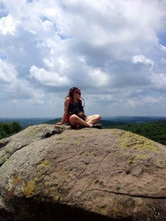 Ainslee sitting on a rock in Shawnee National Forest in Southern Illinois