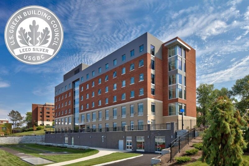 logo reading U.S. Green Building Council LEED Silver on a photo of Genesee Hall
