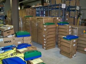 A load of 300 containers & lids arrive in the stock room to be sorted, labeled, and put out into the buildings.