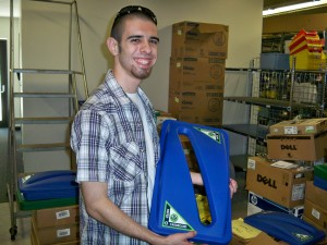 Student Recycling Coordinator Assistant (and former EcoRep), Joey Griggs, getting new containers ready with the standard labels.