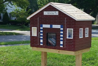 Little Free Library shaped liked a house