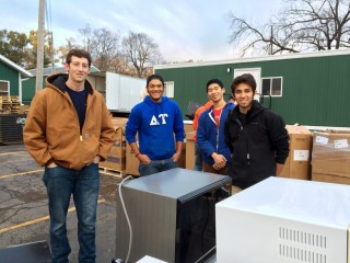 students load appliances for recycling