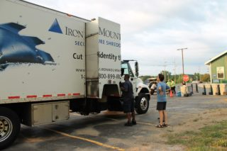 A participant witnessing the shredding of her documents on the shred truck's camera.